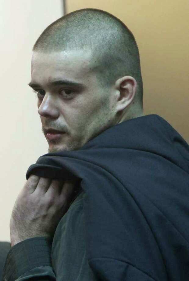 Joran Van der Sloot looks over his shoulder as he leaves the courtroom after his murder trial was postponed at the San Jorge prison in Lima, Peru, Friday, Jan. 6, 2012.  Dutch citizen Joran van der Sloot asked for more time Friday to decide how to plead in his trial for the 2010 murder of a 21-year-old Peruvian woman. His case was postponed until Jan. 11. (AP Photo/Karel Navarro) Photo: Karel Navarro, Associated Press / AP