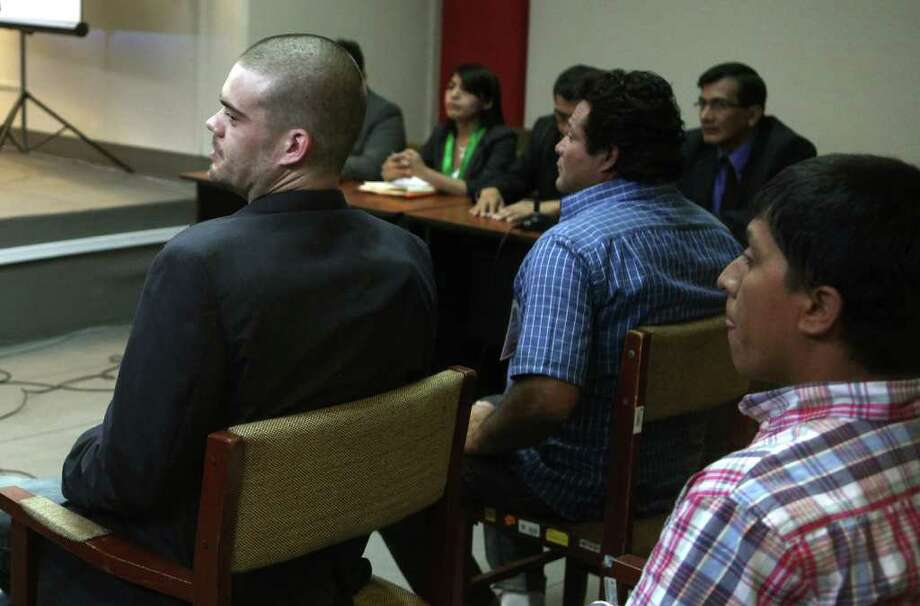 Joran Van der Sloot, left, attends his murder trial along with others accused inside a courtroom at the San Jorge prison in Lima, Peru, Friday Jan. 6, 2012.  Van der Sloot, 24, stands trial Friday for the 2010 murder of the 21-year-old Stephany Flores, of Peru, nearly seven years after he became the prime suspect in the unsolved disappearance of an American teenager on holiday in Aruba. (AP Photo/Karel Navarro) Photo: Karel Navarro, Associated Press / AP