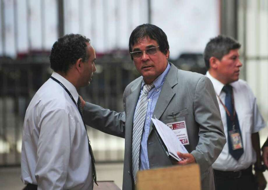 Ricardo Flores (R), father of murdered Peruvian woman Stefani Flores, arrives to the trial of her alleged killer, Dutch national Joran Van der Sloot, at Lurigancho prison in Lima on January 6, 2011. Trial gets in Lima for Van der Sloot, accused of killing Flores in 2010 and who also is a suspect in the disappearance years earlier of an American woman in the Caribbean. AFP PHOTO/ Ernesto Benavides Photo: ERNESTO BENAVIDES, AFP/Getty Images / AFP