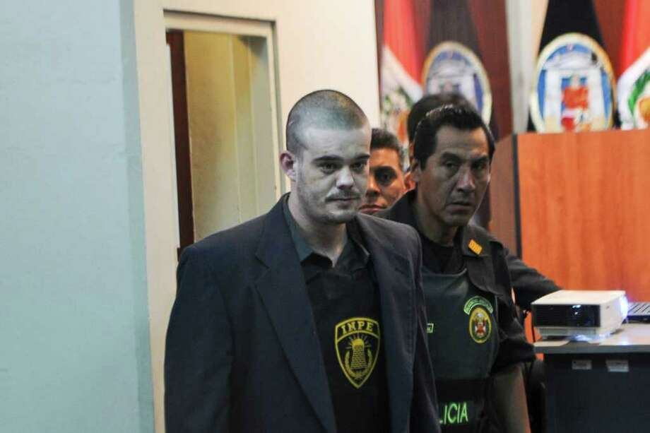 Dutch national Joran Van der Sloot arrives for his preliminary hearing in court in the Lurigancho prison in Lima on January 6, 2011.  Trial gets in Lima for Van der Sloot, accused of killing Flores in 2010 and who also is a suspect in the disappearance years earlier of an American woman in the Caribbean. AFP PHOTO/ Ernesto Benavides Photo: ERNESTO BENAVIDES, AFP/Getty Images / AFP