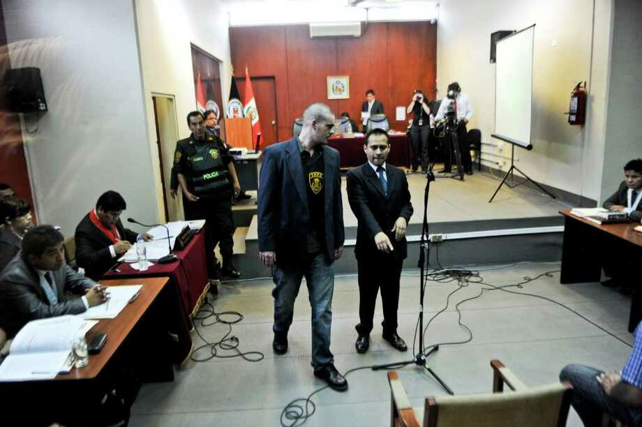 Dutch national Joran Van der Sloot (C) arrives to his preliminary hearing in court in the Lurigancho prison in Lima on January 6, 2011.  Trial gets in Lima for Van der Sloot, accused of killing Flores in 2010 and who also is a suspect in the disappearance years earlier of an American woman in the Caribbean. AFP PHOTO/ Ernesto Benavides Photo: ERNESTO BENAVIDES, AFP/Getty Images / AFP