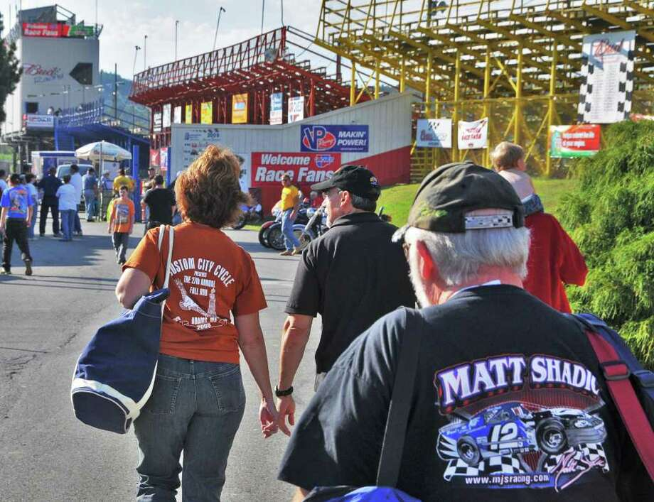Race fans crowd into Lebanon Valley Speedway in New Lebanon Saturday evening September 5, 2009.  The track and surrounding grounds were flooded by late July?s torrential storms and dozens of racers lost their vehicles and their equipment. But a month later, racing is back to normal. (John Carl D'Annibale / Times Union) Photo: John Carl D'Annibale / 00005381A