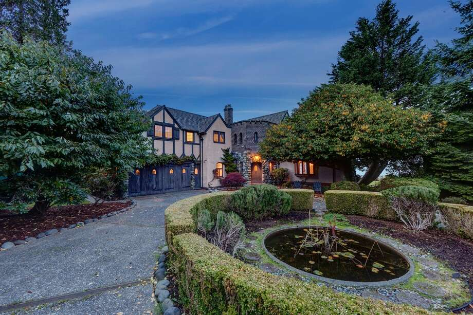This Tudor-style mansion, built in 1925, sits on half an acre along 100 feet of Puget Sound shoreline in Magnolia, 4570 W. Cramer St. The 4,050-square-foot house has three bedrooms, 2.5 bathrooms, two fireplaces, leaded glass, cathederal ceilings, tons of exposed wood, a circular driveway, a pond and extensive mountain and sound views. It's listed for $2.495 million. Here's a video of the property. Photo: Darin Cruzen/RE/MAX Metro Realty