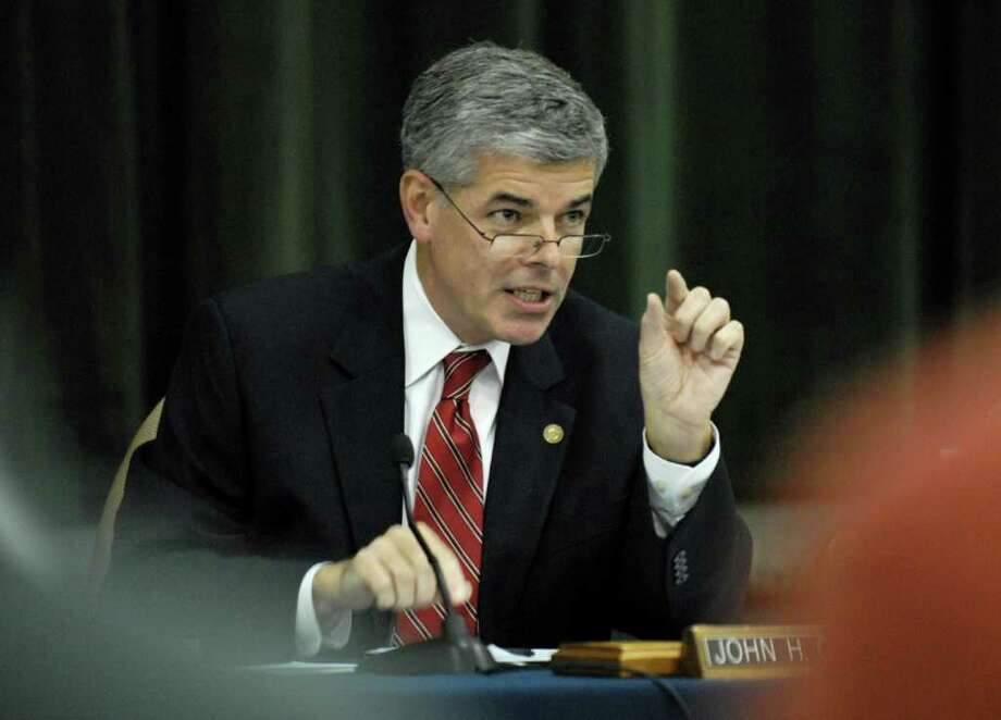 Bethlehem Town Town Supervisor, Jack Cunningham, discusses the 2010 Town of Bethlehem budget during Wednesday nights town board meeting in Delmar, September 23, 2009. (Will Waldron / Times Union) / j=0401_COLONIE