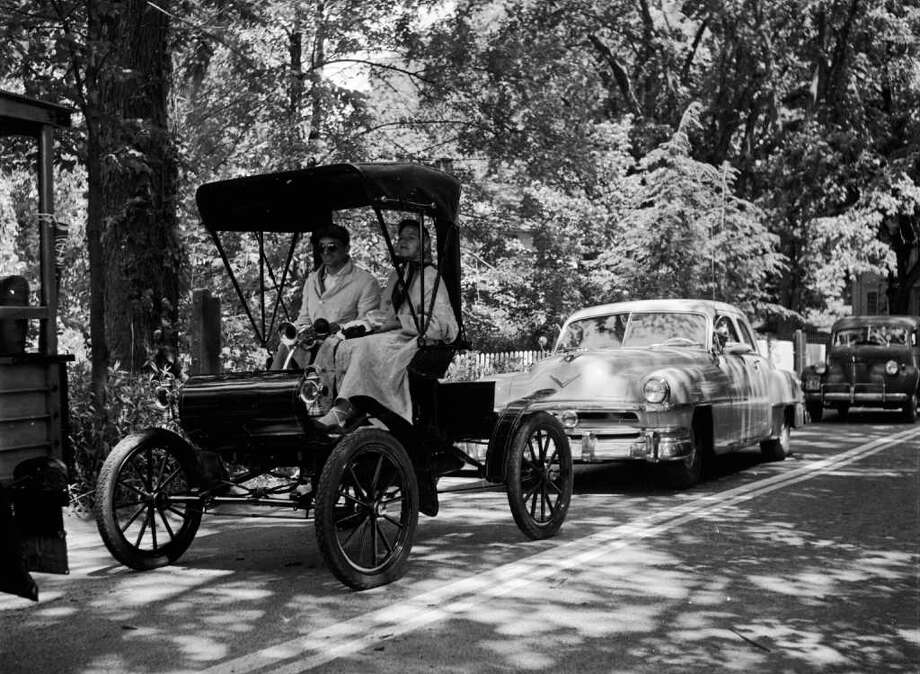 Oldsmobile started with cars in 1901. Here's a shot of a 1901 Olds on the road in the 1950s. A century later, Olds had become known as, well, a car for old people. It built its last car in 2004. Photo: Three Lions, Getty Images / Hulton Archive