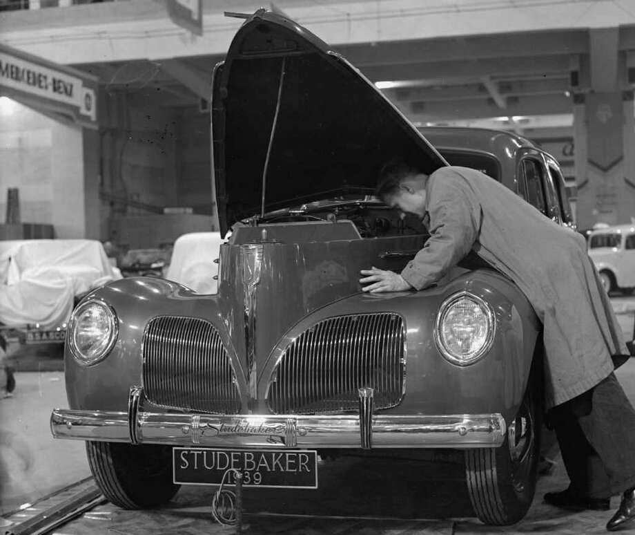 Ever since the transition away from horses (and probably before), the  transportation industry has been littered with once-iconic companies  that failed. Credit Studebaker with surviving the change from  horse-drawn wagons and buggies, which it started building in 1852, to  automobiles. In this picture, from1938, a mechanic at a motor show  checks out a 1939 Studebaker. But Studebaker fell victim tocompetition from the Big Three (General  Motors, Ford and Chrysler) and stopped production in 1966. Photo: London Express, Getty Images / Hulton Archive