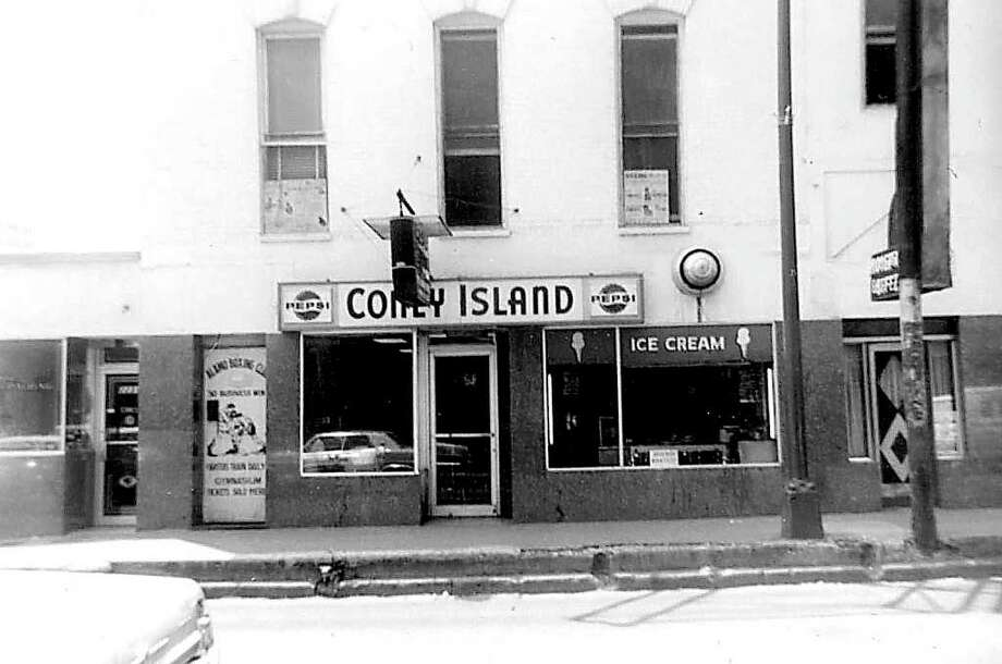 """West side of St. Mary's Street, near the intersection with College Street. This was taken on my 10th birthday in 1965. After lunch at the Coney Island, my parents and I went across the street to the Empire Theater to see """"Goldfinger."""" Photo: Kolarik / To be published ONLY on the iPad edition."""