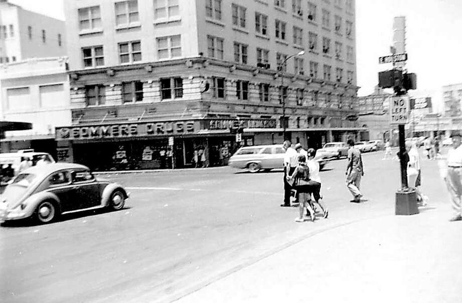 Northwest corner of Alamo and Houston streets: My father wanted the picture of Sommers Drugs because he'd hung around there during World War II. It apparently had a good supply of then-hard-to-get Coca-Cola. Photo: Kolarik / To be published ONLY on the iPad edition.
