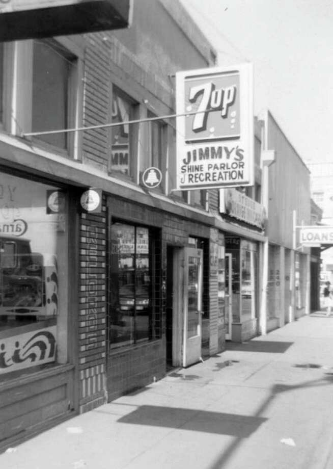 South Side of Houston Street between Flores and Cameron streets. Jimmy's was a combination shoeshine parlor and pool hall that sold 16-ounce bottles of RC Cola and Big Red for 15 cents. Photo: Kolarik / To be published ONLY on the iPad edition.
