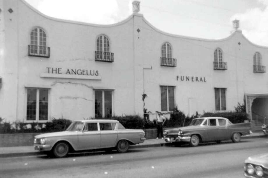 South Side of Houston Street, west of San Saba Street. I was never sure why my father wanted a picture of the Angelus Funeral Home, aside from the fact it was just down the street from Santa Rosa Hospital and he liked the juxtaposition. Photo: Kolarik / To be published ONLY on the iPad edition.