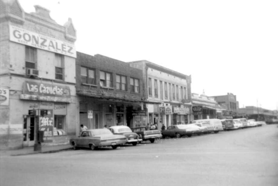 Produce Row, looking west from Santa Rosa Street. We were interested in the building next to the one sporting the Gonzalez campaign sign. It housed the Guadalupana Drugstore, which sold 12-ounce bottles of Coca-Cola for a dime and had the world's most powerful fan in lieu of air conditioning. Photo: Kolarik / To be published ONLY on the iPad edition.