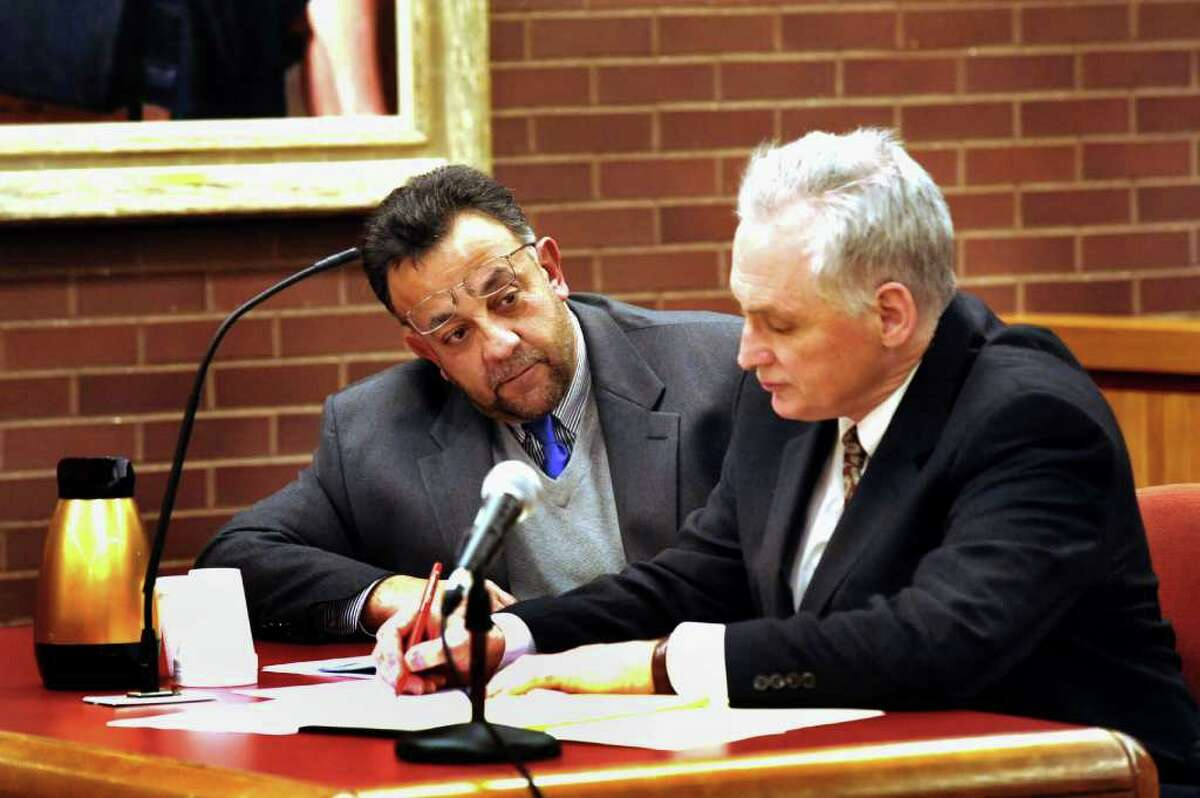 Danbury businessman Joseph DaSilva Jr. talks with his defense attorney, Gene Riccio, in state Superior Court in Danbury Wednesday Jan. 3, 2012, the first day of jury selection in DaSilva's trial on charges that include manslaughter.