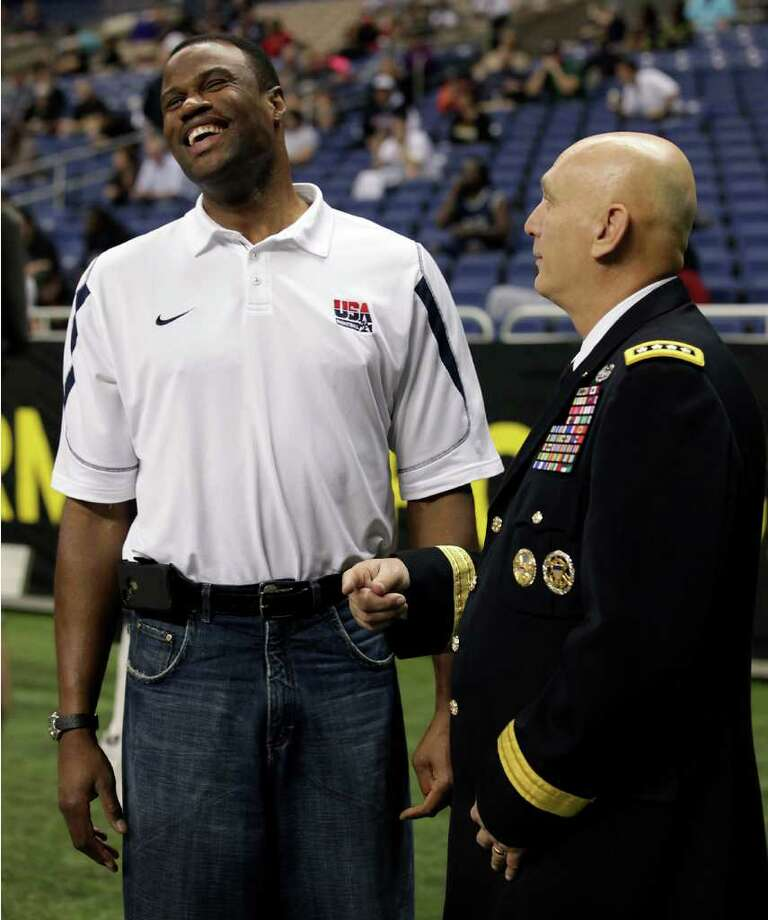 Gen Raymond Odierno, Chief of Staff of the U.S. Army, right, gets a reaction from former Spurs great David Robinson, whose son Corey Robinson was competing in U.S. Army All-American Bowl National Combine at the Alamodome.  Friday, Jan.6, 2012. Photo Bob Owen/rowen@express-news.net Photo: BOB OWEN, SAN ANTONIO EXPRESS-NEWS / rowen@express-news.net