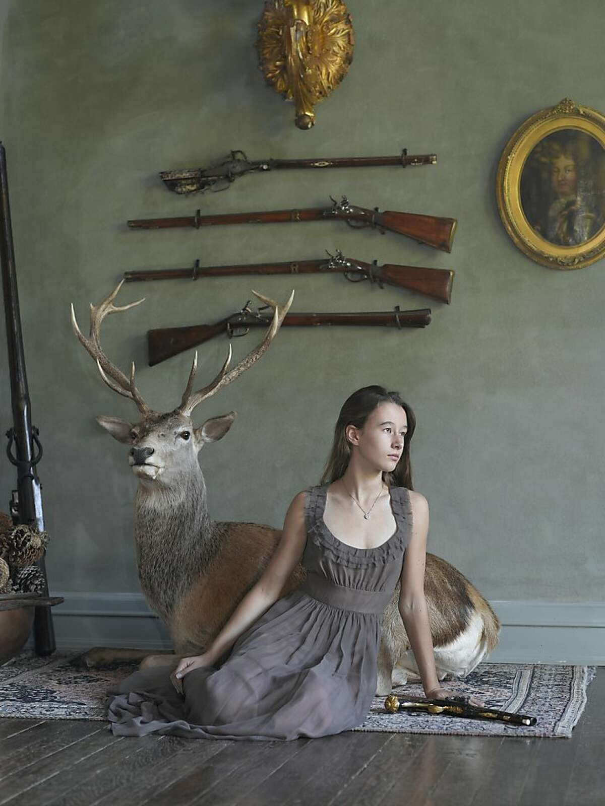An image of Greta of Napa Valley, Calif., with her English Forsyth sytem scent bottle pistol, ca. 1820 by Lindsay McCrum appears in her book,