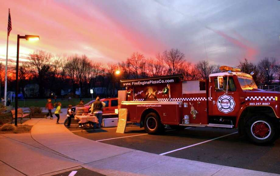 Marty McCarthy operates his pizza making fire truck at the Wakeman Boys and Girls Club in Southport, Conn. on Friday January 6, 2012. McCarthy has been using the fire truck to sell pizza since his restaurant burned down last March. Photo: Christian Abraham / Connecticut Post