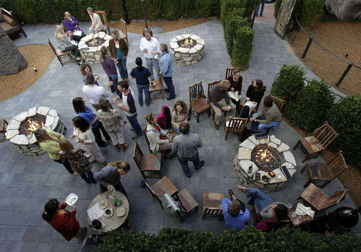 Guests gather for pre-dinner drinks and appetizers in the patio at Restaurant 1833 in Monterey.