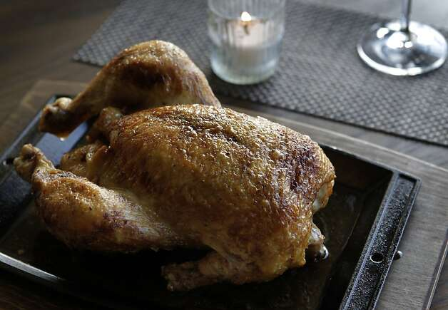 A whole roasted truffle chicken is served at Restaurant 1833. Photo: Paul Chinn, The Chronicle
