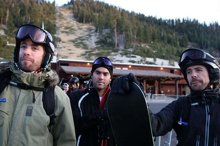 Enrique Acevedo (middle) and Nicolaus Ibarguen (right) coming off the slopes of Heavenly Valley ski resort in South Lake Tahoe, Calif., on Wednesday, January 4, 2012.  Gunbarrel ski run is behind them as 26 ski runs out of the normal 97 are running. Photo: Liz Hafalia, The Chronicle