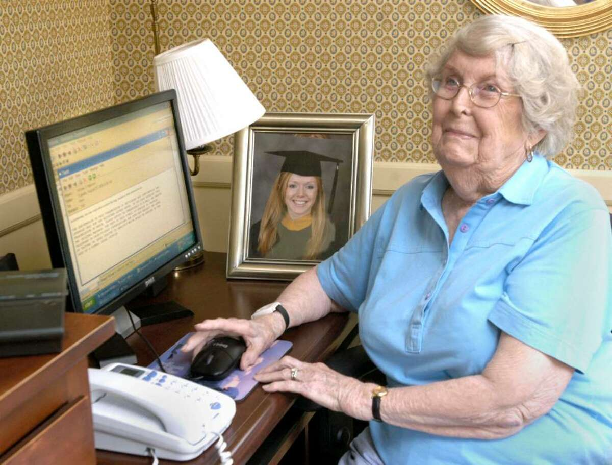 Marion Mannion sits at the computer in her home where she exchanges emails from granddaughter Beth Mannion, 21, who is teaching English in Viet Nam this Summer. Photo taken August 25, 2009