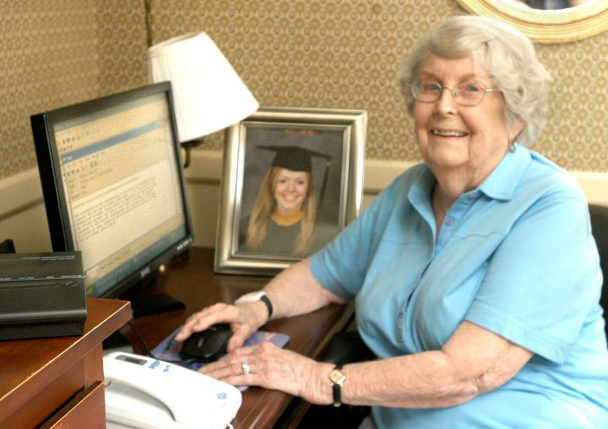 Marion Mannion sits at the computerin her home where she exchanges emails from granddaughter Beth Mannion, 21, who is teaching English in Viet Nam this Summer. Photo taken August 25, 2009