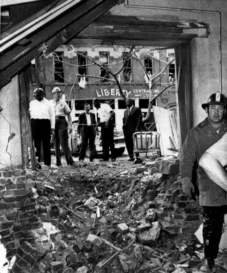 This large crater is the result of a bomb that exploded near the 16th Street Baptist Church in Birmingham, Ala., in 1963, killing four small black girls. Birmingham's economy suffered from the strife in the city over the civil rights movement. / AP