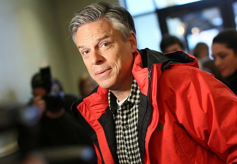 CONCORD, NH - JANUARY 06:  Republican presidential candidate, former Utah Gov. Jon Huntsman speaks to members of the press before addressing the New England College Convention January 6, 2012 in Concord, New Hampshire. Huntsman, who recently received the endorsement of the Boston Globe, also commented on a controversial political web ad created by supporters of Ron Paul that uses images of Huntsman's adopted daughters.  (Photo by Win McNamee/Getty Images) Photo: Win McNamee, Getty Images