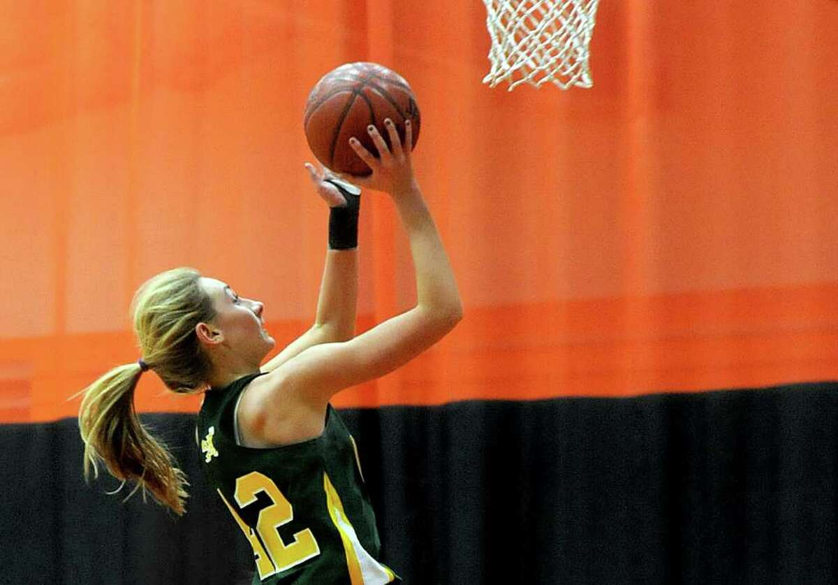 Trinity Catholic's Mackenzie Griffin takes a shot during the girls basketball game at Stamford High School on Friday, January 6, 2012.
