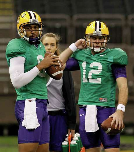 LSU quarterbacks Jordan Jefferson (left) and Jarrett Lee are shown during practice for the BCS Championship at the Louisiana Superdome in New Orleans on Thursday. Photo: AP