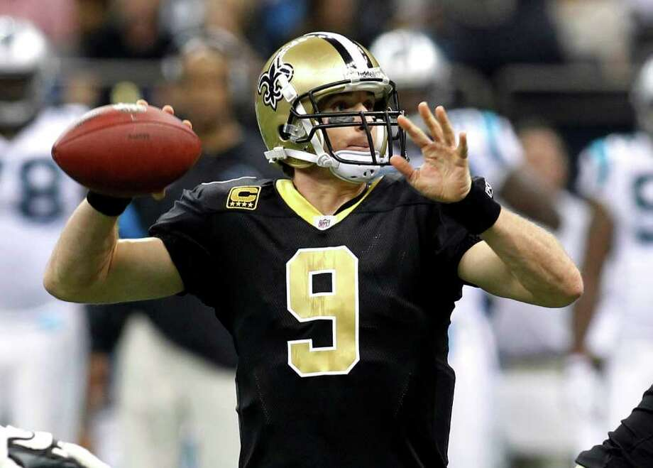 Saints quarterback Drew Brees' matchup with Lions QB Matt Stafford is the first playoff game between two 5,000-yard passers. Photo: AP