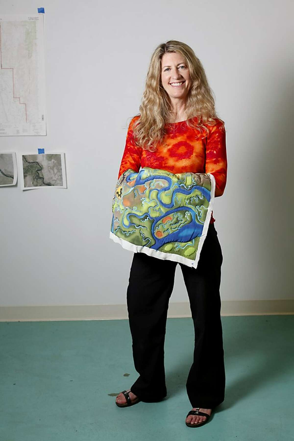 Linda Gass is an artist who creates stitched paintings on silk. She is photographed in her studio in Palo Alto, Calif., Tuesday, November 1, 2011. (**note - that is how she refers to her work, not as quilts**)(to be cut out)