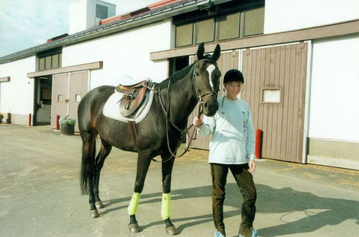 Seventeen-year-old Megan Chance stands with her horse, Burma's Lady, at the New Jersey stable where she was riding in 2000. She's been reunited with the horse after years of thinking she had died and will take her home to North Carolina.