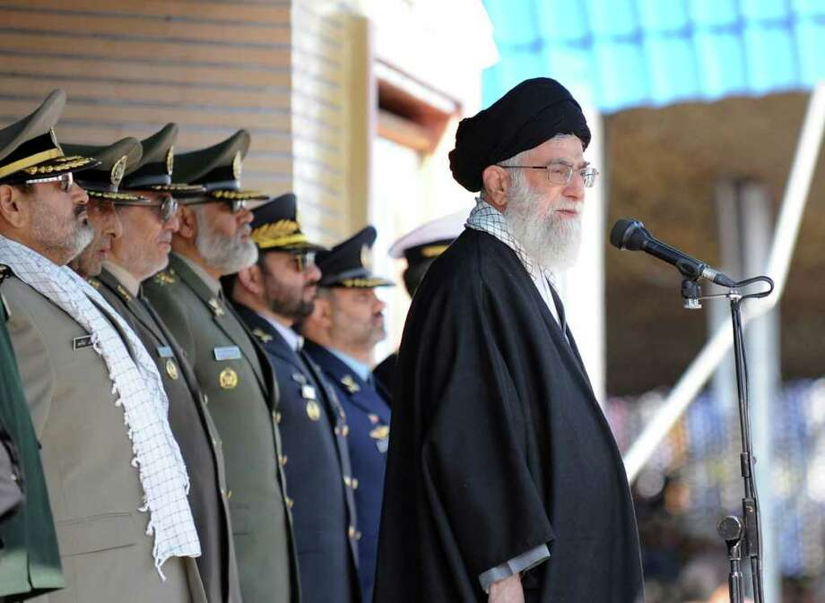 Iranian supreme leader Ayatollah Ali Khamenei in front of high ranking armed forces members. Iran's seizure of a British tanker is driving oil prices higher.  , Photo: STR / AP
