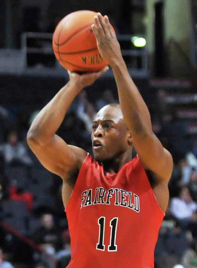 Fairfield's #11 Desmond Wade shoots from the three point line during their MAAC game against Siena at the Times Union Center in Albany Friday Jan. 6, 2012.   (John Carl D'Annibale / Times Union) Photo: John Carl D'Annibale / 00015373F