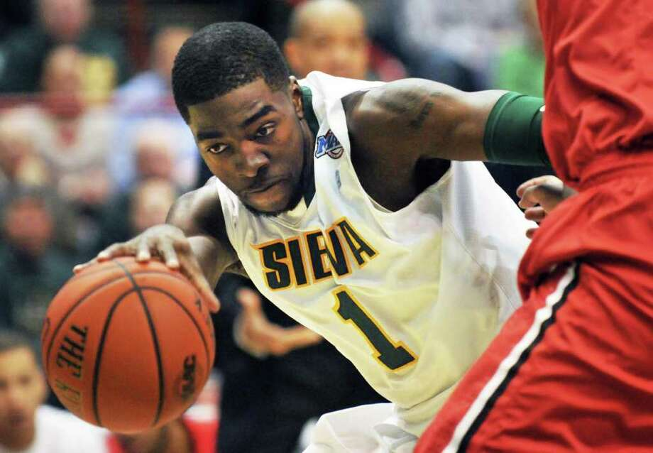 Siena's #1 OD Anosike drives past Fairfield defense during their MAAC game at the Times Union Center in Albany Friday Jan. 6, 2012.   (John Carl D'Annibale / Times Union) Photo: John Carl D'Annibale / 00015373F