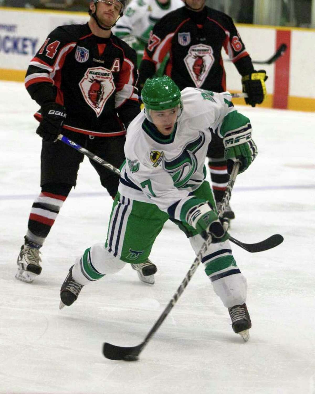 The Whalers' Alec Kirschner fires a shot against the Akwesasne Warriors Friday night at the Danbury Arena.