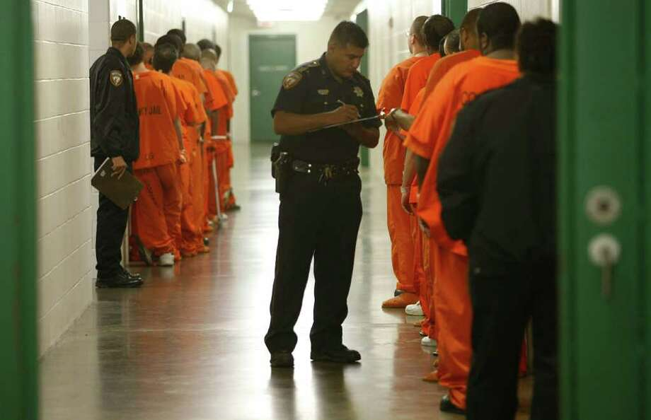 With a 31 percent decline in the Harris County Jail population since 2008, officers have had fewer inmates to process, and the practice of sending overflow inmates to neighboring counties or states soon will end. Photo: Mayra Beltran / Houston Chronicle
