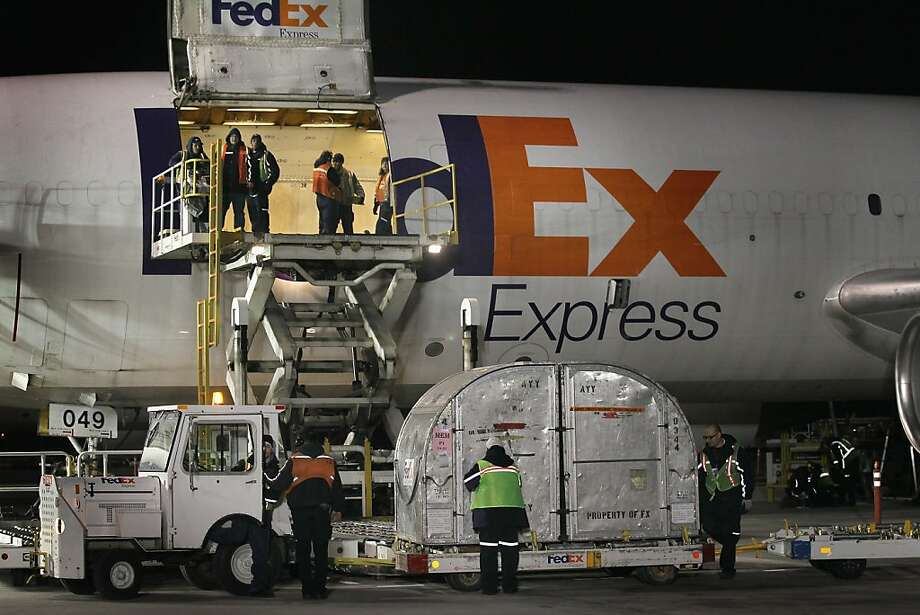 CHICAGO, IL - DECEMBER 12:  Workers load an aircraft at a FedEx facility at O'Hare Airport on December 12, 2011 in Chicago, Illinois. With an anticipated 17 million packages being shipped, today is expected to be the busiest day ever in the nearly 40-year history of the company. (Photo by Scott Olson/Getty Images) Photo: Scott Olson, Getty