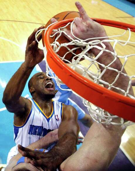 Nuggets center Kosta Koufos (not pictured) has a hand in keeping the Hornets' Carl Landry from scoring. Photo: AP