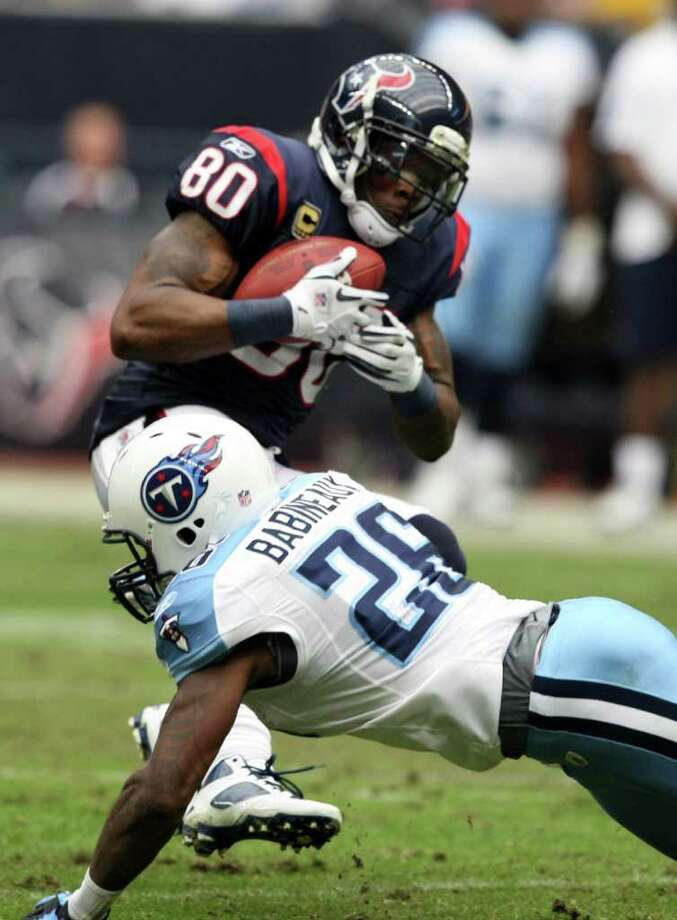 Houston Texans wide receiver Andre Johnson (80) is tackled by Tennessee Titans strong safety Jordan Babineaux (26) during the first half of an NFL football game on Sunday, Jan. 1, 2012, in Houston, Texas. (AP Photo/Waco Tribune Herald/ Jose Yau) Photo: Jose Yau