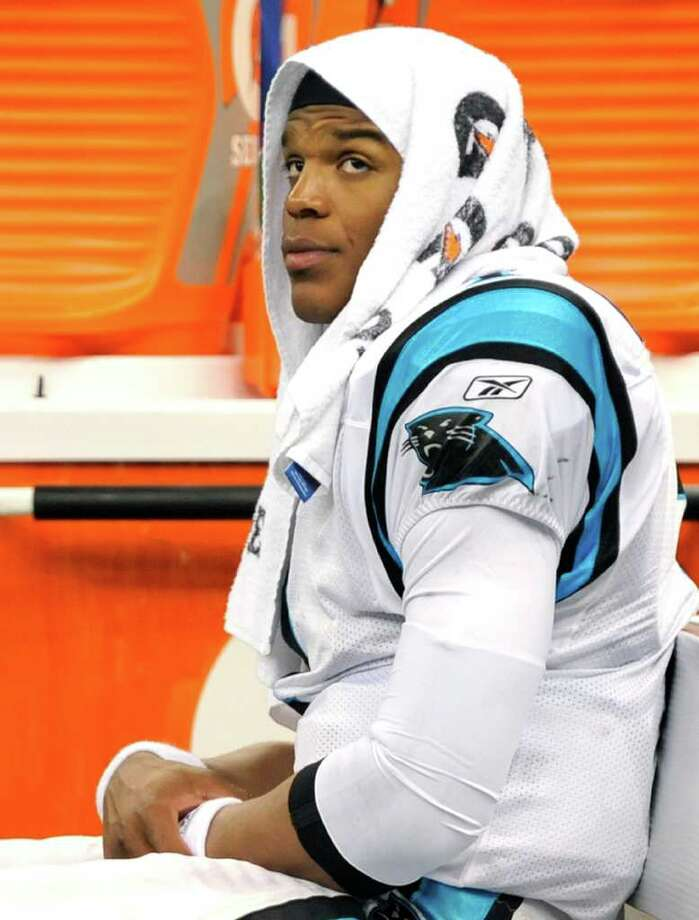 Carolina Panthers quarterback Cam Newton sits on the bench late in the fourth quarter of an NFL football game against the New Orleans Saints in New Orleans, Sunday, Jan. 1, 2012. The Saints won 45-17. (AP Photo/Bill Feig) Photo: Bill Feig