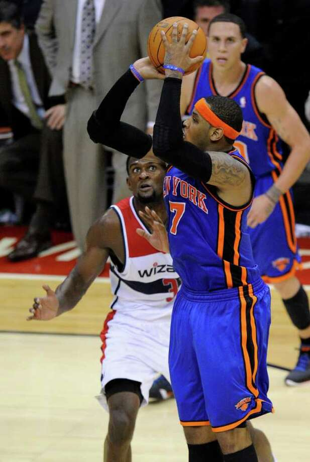 New York Knicks forward Carmelo Anthony (7) takes a shot against Washington Wizards forward Chris Singleton, left, during the second half of an NBA basketball game on Friday, Jan. 6, 2012, in Washington. The Knicks won 99-96. (AP Photo/Nick Wass) Photo: Nick Wass