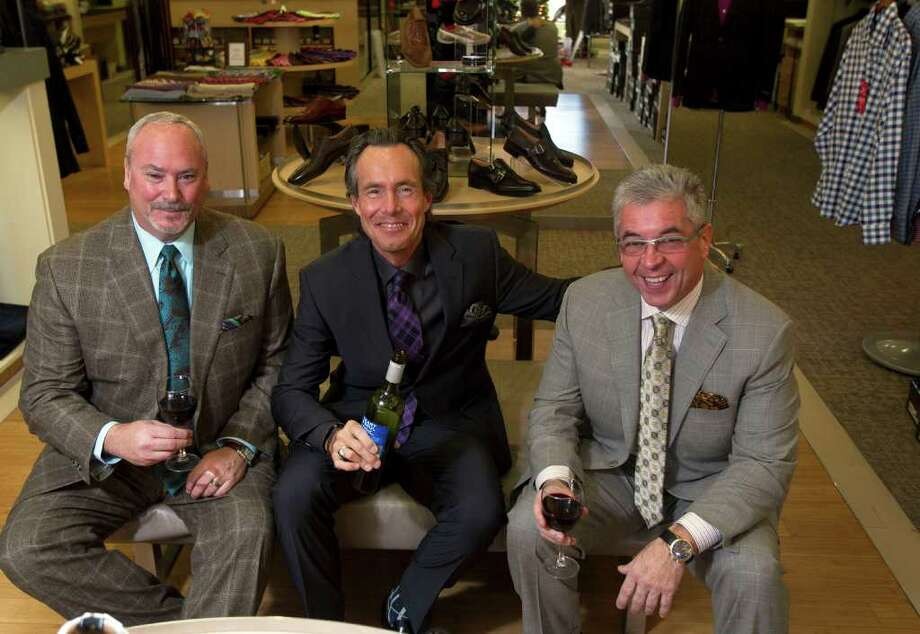 Norton Ditto general manager Brian Kreps, center, has a drink with customers Jeff Carr, right, and Olivier Thierry at the store in The Woodlands. The clothing retailer offers customers beverages from water to soft drinks to wine while shopping. Photo: James Nielsen / © 2011 Houston Chronicle