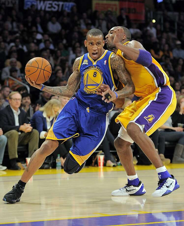 Golden State Warriors shooting guard Monta Ellis, left, powers by Los Angeles Lakers shooting guard Kobe Bryant during the first half of their NBA basketball game, Friday, Jan. 6, 2012, in Los Angeles. (AP Photo/Mark J. Terrill) Photo: Mark J. Terrill, Associated Press