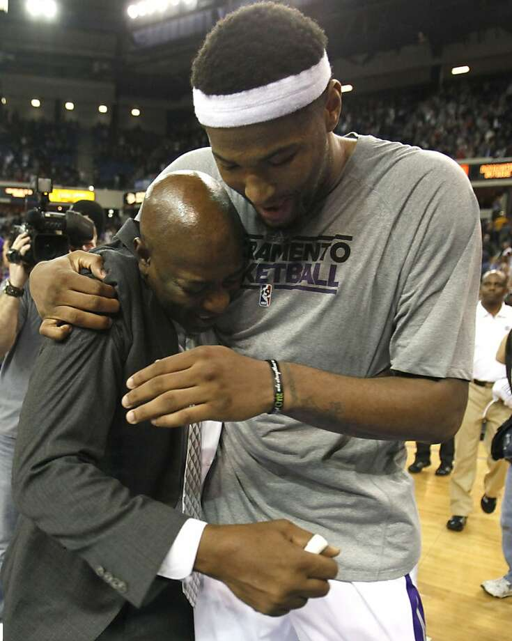 Keith Smart, the new head coach of the Sacramento Kings is hugged by center DeMarcus Cousins, after the Kings beat the Milwaukee Bucks 103-100 in an NBA basketball game in Sacramento, Calif., Thursday, Jan. 5, 2012.   Smart had been named the teams head coach after previous head coach Paul Westphal was fired earlier in the day.(AP Photo/Rich Pedroncelli) Photo: Rich Pedroncelli, Associated Press