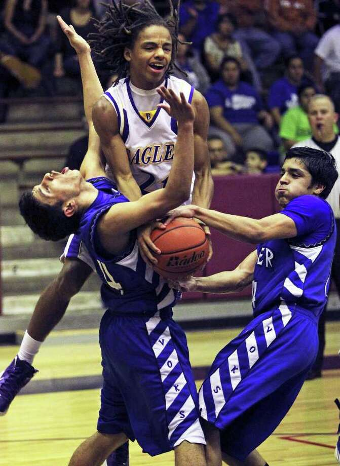 Brackenridge forward Ramon Richard (center) draws a foul in the lane from Lanier's Rodrigo Garcia (left) as Martin Sanchez of the Voks tries to make a steal. Photo: TOM REEL, SAN ANTONIO EXPRESS-NEWS / © 2011 San Antonio Express-News  MAGS OUT; TV OUT; NO SALES; SAN ANTONIO OUT; AP MEMBERS ONLY; MANDATORY CREDIT; EFE OUT