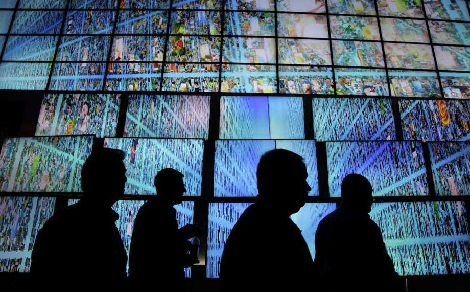 Ultrabooks will try to catch up with Apple, and catch the eyes of buyers, at the International Consumer Electronics Show, which starts Tuesday in Las Vegas. Photo: Julie Jacobson / AP