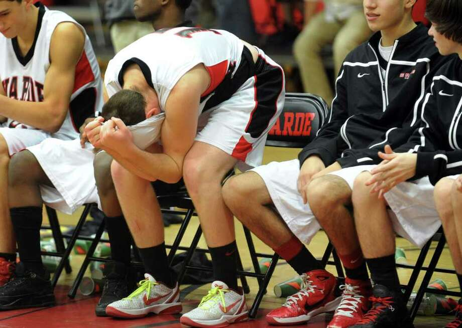 Fairfield Warde's #15 Joseph Bartolomeo reacts after the team looses to Dandury, during boys basketball action in Fairfield, Conn. on Friday January 6, 2012. Photo: Christian Abraham / Connecticut Post