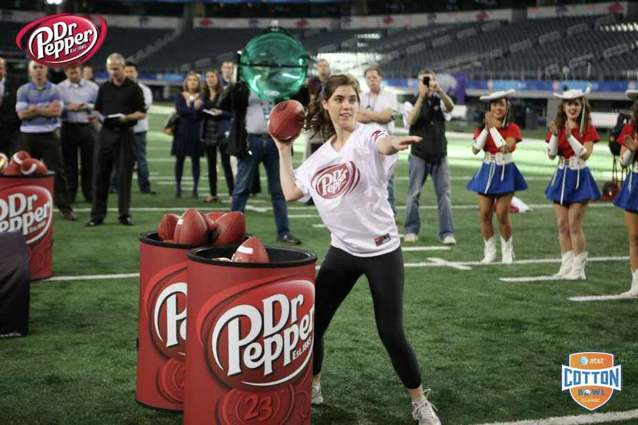 Courtney Brand, 20, a Georgetown University student from Greenwich, competes in the Dr Pepper football toss for a $100,000 scholarship Thursday at Cowboys Stadium in Arlington, Texas. Brand did not qualify for the final round, but did receive a $7,500 scholarship for her efforts. Photo: Contributed Photo