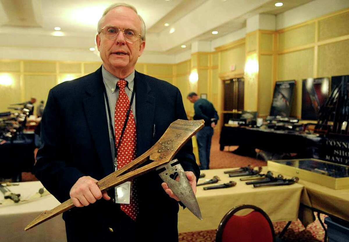 Dave Kleiner holds a spiked gunstock club at the seventh annual East Coast Fine Arms Show at the Plaza Hotel in Stamford on Saturday, January 7, 2012.