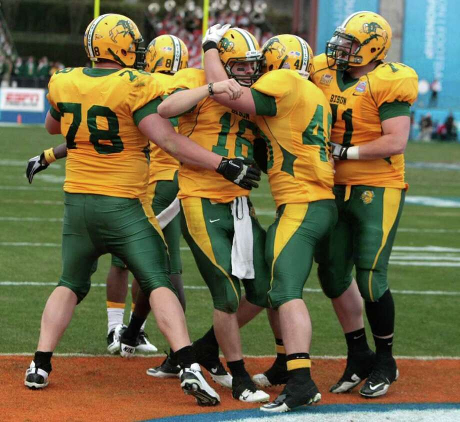 (center) North Dakota State University quarterback Brock Jensen (16) celebrates a rushing touchdown with his North Dakota State University  teammates.  During the fourth quarter of  Sam Houston State University  and North Dakota State University match up in the 2012 Division I Football Championship at Pizza Hut Park in Frisco, Texas January 7, 2011. North Dakota State University beat Sam Houston State University 17-6. Photo: Billy Smith II, Chronicle / © 2012 Houston Chronicle